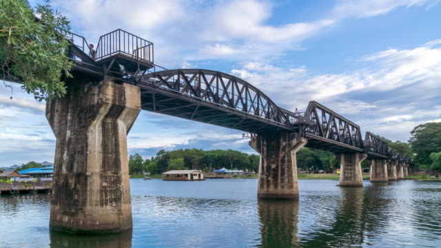 Historical bridge over River Kwai, and Death Railway, built by Japanese and prisoner during World War II, Kanchanaburi, Thailand - Time Lapse