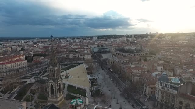 Historical center of Nimes, France. Aerial view of the square, the arena and the tower of the Catholic Church