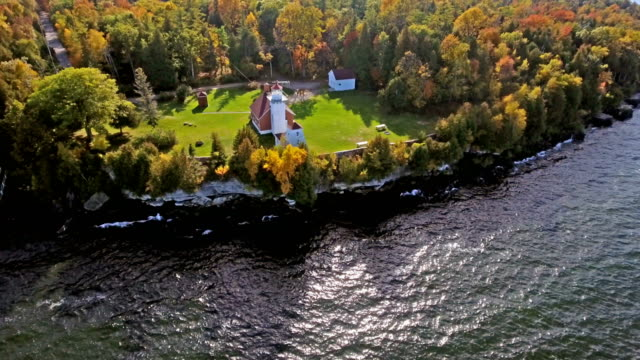 Historical Great Lakes lighthouse on a fall October day along Lake Michigan video