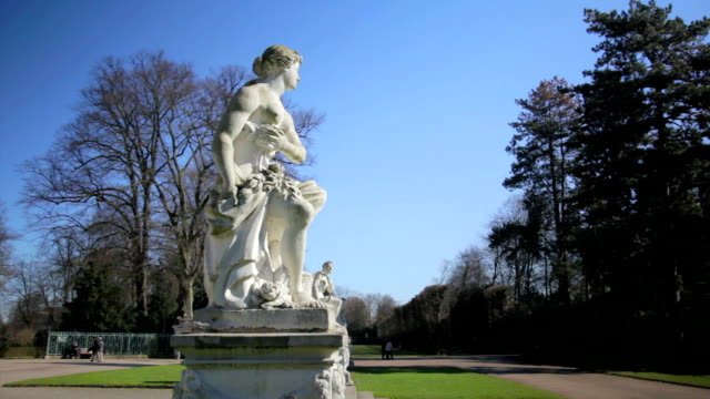 historical sculptures and a blue sky in 1080p video