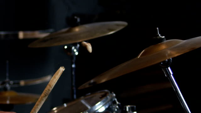 Hitting on drum cymbal with drumstick. Drumstick breaking from heavy hit in slow motion 200 fps. Shot on RED HELIUM Cinema Camera.