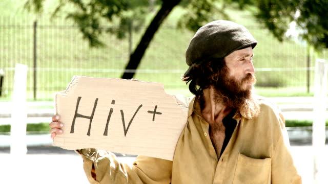 에이즈바이러스 긍정적임과 사람 - aids 스톡 비디오 및 b-롤 화면