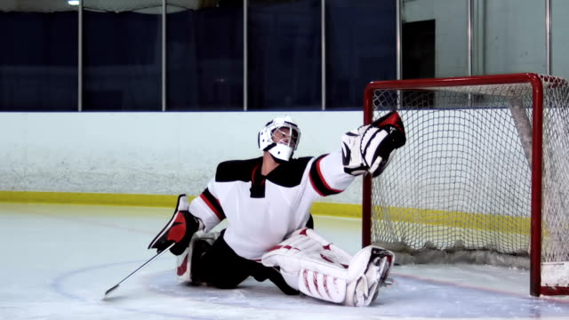 hockey player goalie glove save - hockey stock videos and b-roll footage