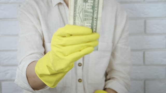 hold money in gloves. - eastern european descent stock videos & royalty-free footage