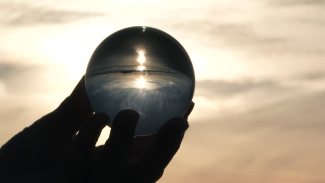 Holding A Beach Sunset In Crystal Ball