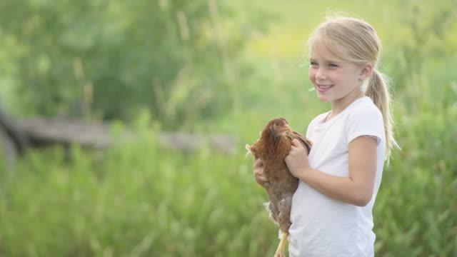 Holding a Farm Chicken video