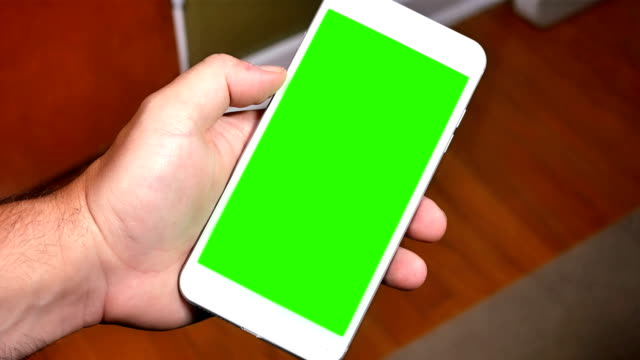 Holding Green Screen Smart Phone Portrait Mode video