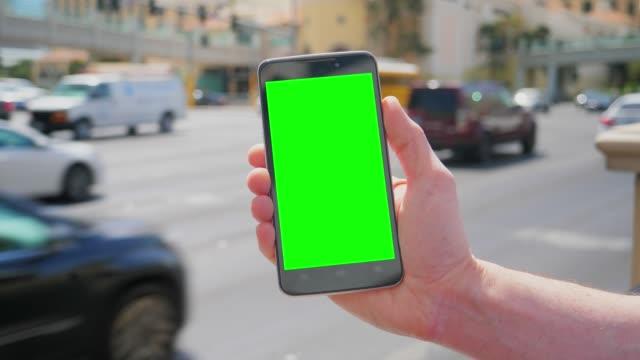 Holding Green Screen Smartphone Near Las Vegas Boulevard video
