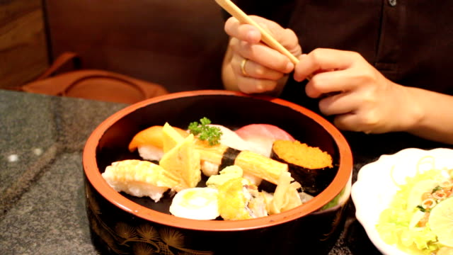 Holding Sushi By Disposable Chopsticks video
