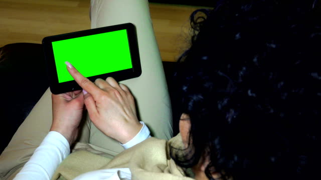 Holding Touchscreen Device, Close-up of female hands using a smart phone. chroma-key, green-screen, UHD stock video alpha luma matte included video