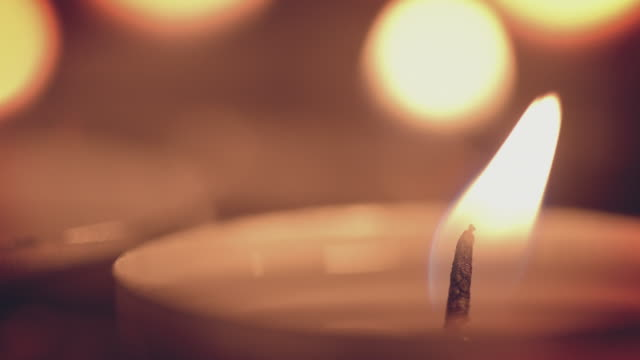 Holiday Candles Holiday tea light candles. 4k video background. zen like stock videos & royalty-free footage
