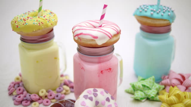 4K - Holidays dessert. Milkshake with Donuts video