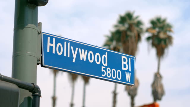 Hollywood boulevard street sign and traffic lights in 4k slow motion 60fps video