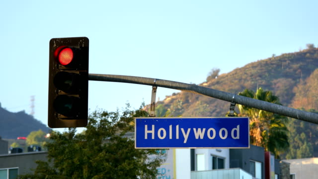 Hollywood boulevard street sign and traffic lights in 4k video