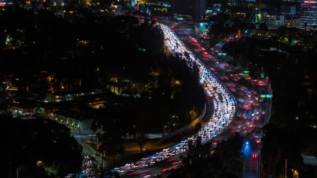 hollywood freeway i los angeles, kalifornien natt timelapse - hollywood sign bildbanksvideor och videomaterial från bakom kulisserna