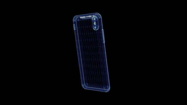 vídeos de stock, filmes e b-roll de holograma de um smartphone rotativa - holograma
