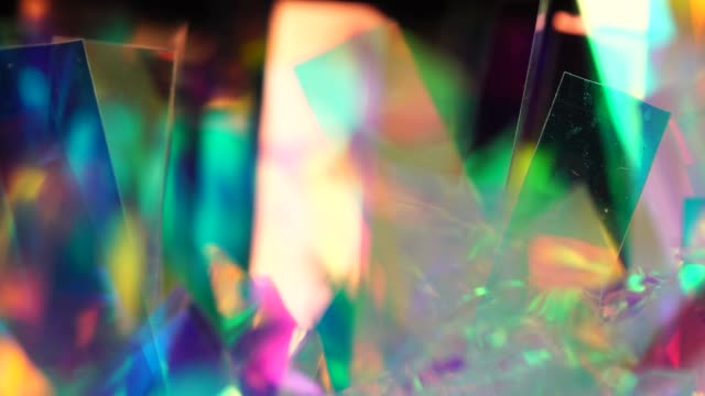 Holographic background. The surface of the crystals and prism. Sparkling highlights and rainbow colors Blue and purple neon festive texture. Pastel neon colors defocused lights bokeh. Sparkling highlights and rainbow colors. Abstract holographic background prism stock videos & royalty-free footage