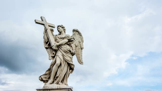 Holy angel with the cross, at Ponte Sant' Angelo, Rome, Italy. Time lapse video