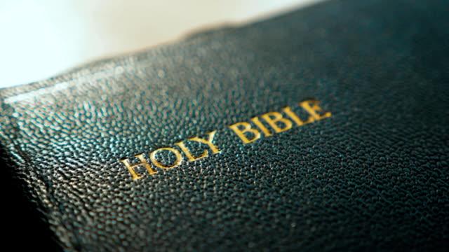 Holy Bible. Catholic sacred religious book. Faith in God concept catholicity for faith spirituality the holy bible lifestyle and religion - vídeo