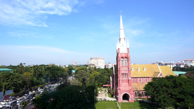 vídeos de stock e filmes b-roll de holy trinity anglican church and traffic jam in  yangon city and a lots of cars, in rush hour traffic jam heaviest, myanmar - climate clock