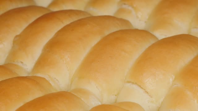 Home baked crescent rolls just taken from oven 4K Home baked crescent rolls just taken from oven 4K 2160p UHD panning video - Tasty dough crescent rolls  close-up 4K 3840X2160 UHD footage bun bread stock videos & royalty-free footage