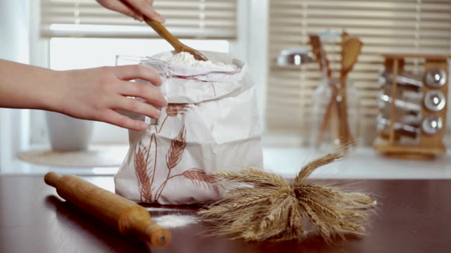 Home baking ingredients. Chef puts flour in glass. Home baking ingredients video