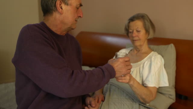 Home Caregiver - Giving Medicine Husband to Wife video