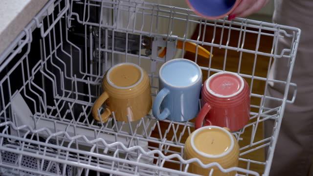 Home Dishwasher Loading a residential dishwashing appliance dishwasher stock videos & royalty-free footage