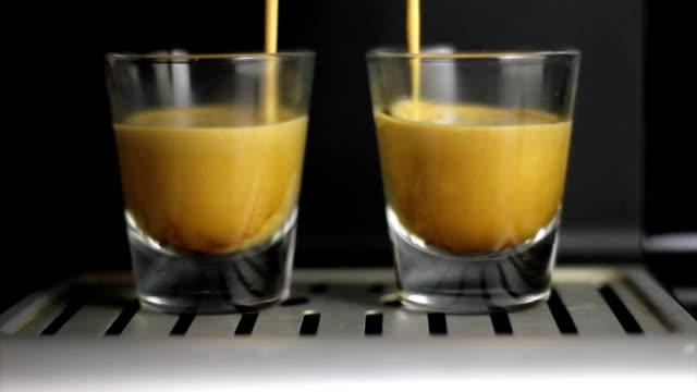 Home espresso machine is making double espresso. video