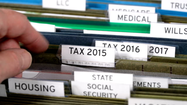 Home filing system for taxes organized in folders video