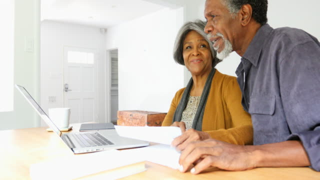 Home Finances On Computer by African American Senior Couple video