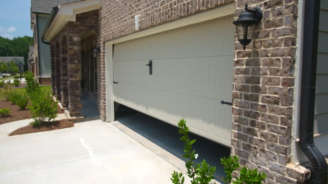 home garage door opens angled lowering - portoni video stock e b–roll
