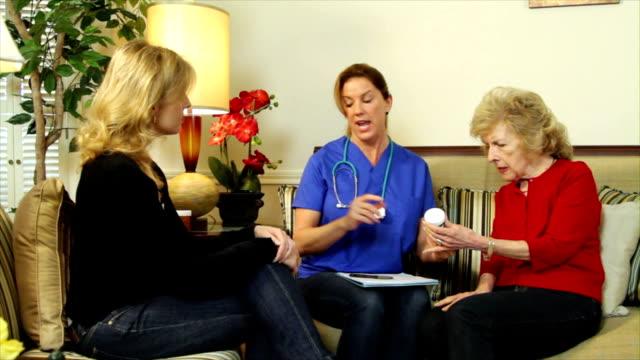 Home health care nurse explaining prescriptions video