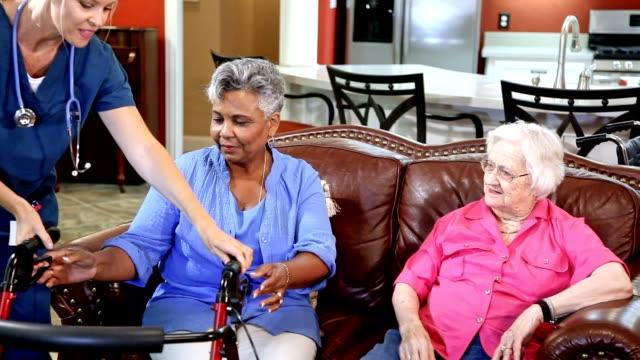 Home healthcare nurse evaluates senior adult patients at nursing home. video