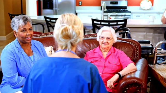 home healthcare nurse evaluates senior adult patients at nursing home. - senior care stock videos and b-roll footage