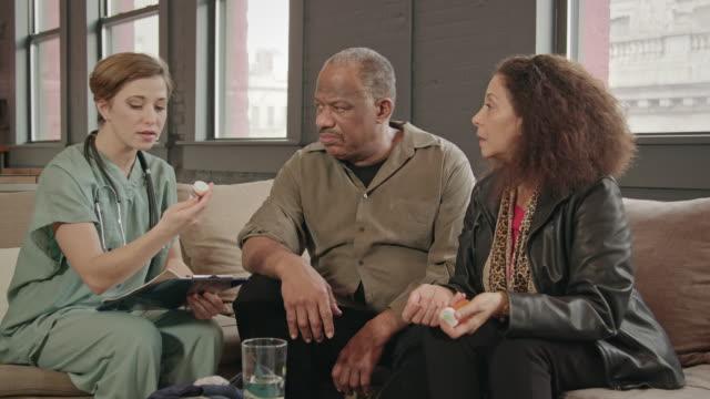 Home Healthcare Provider Discusses Medicine with Senior Couple video
