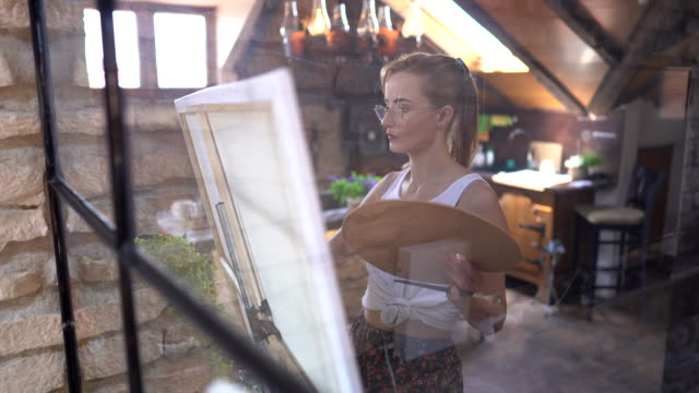 Home hobbies Young woman painting on canvas small business saturday stock videos & royalty-free footage