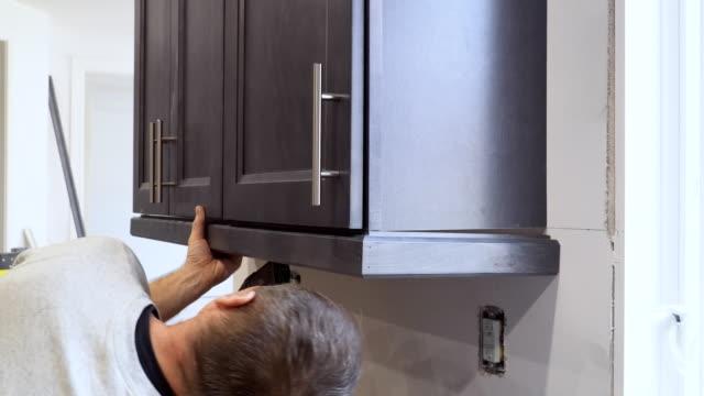 Home improvement remodel modern kitchen interior cabinet Home improvement remodel modern kitchen interior cabinet craftsman architecture stock videos & royalty-free footage