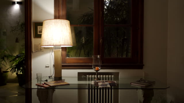 Home interior, galss table with electric lamp