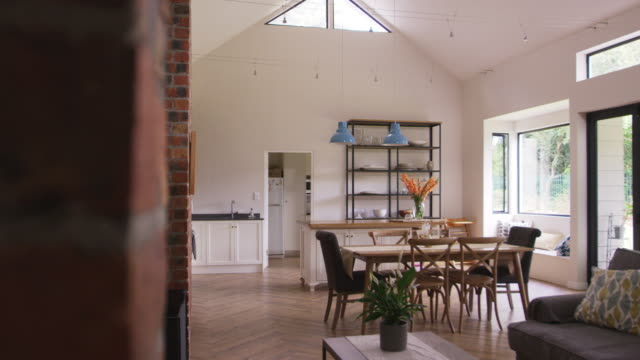 Home Interior With Open Plan Kitchen, Lounge And Dining Area