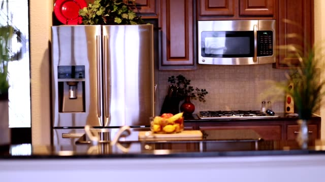 Home kitchen cabinets, appliances pan. video