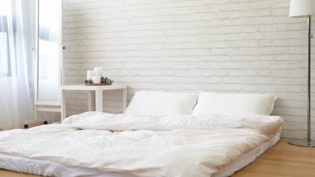 home modern bright white bedroom home modern bright white bedroom with copy space nobody double bed stock videos & royalty-free footage