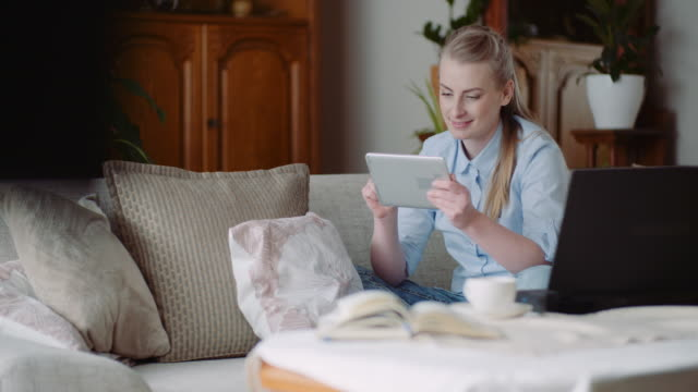 home office woman working on tablet