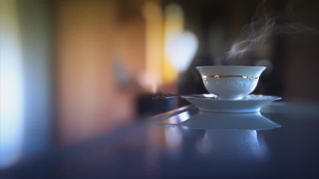 Home or office video. Steaming tea, coffee cup looping. video