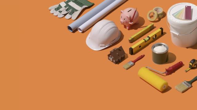 home renovation and construction - salvadanaio video stock e b–roll