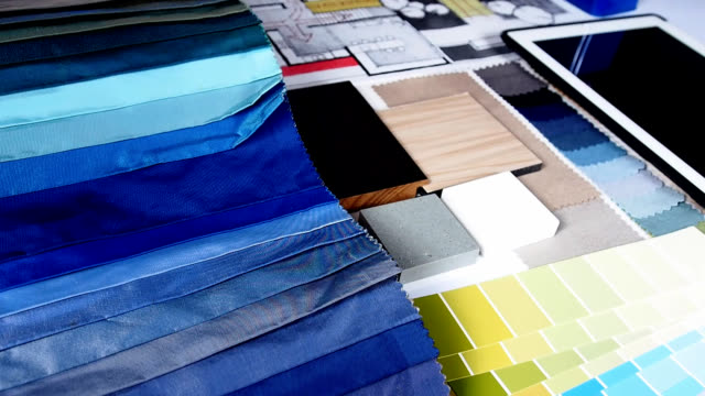 Home renovation & improvement concept Top view of architect & interior designer's working table with hand-drawn illustration and material sample / Home renovation & improvement concept fabric swatch stock videos & royalty-free footage