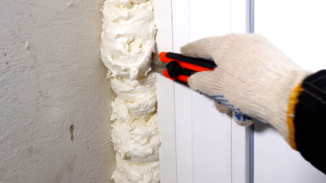home renovation new plastic white pvc door installation - poliuretano polimero video stock e b–roll