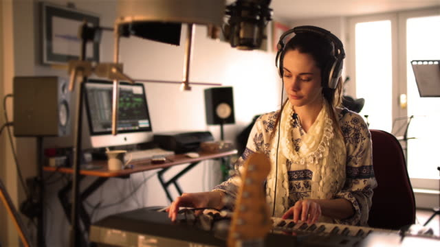 Home studio hippy pianist woman