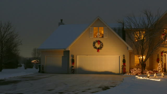 Home With Festive Outdoor Christmas/Holiday Lighting and Snow