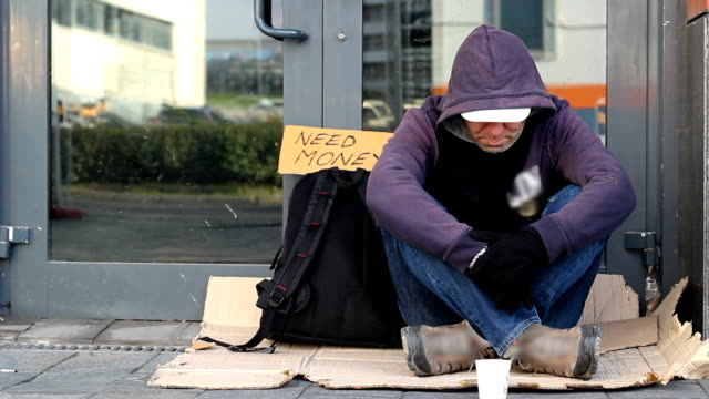 homeless beggar man begging on the street - homelessness stock videos & royalty-free footage